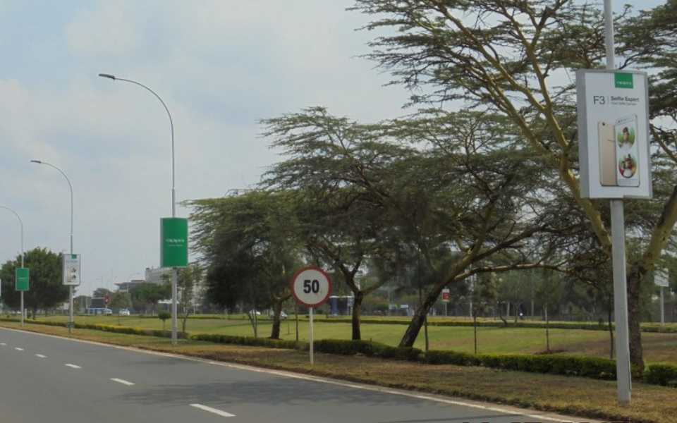 19 street poles on the Driveway towards the main KQ exit